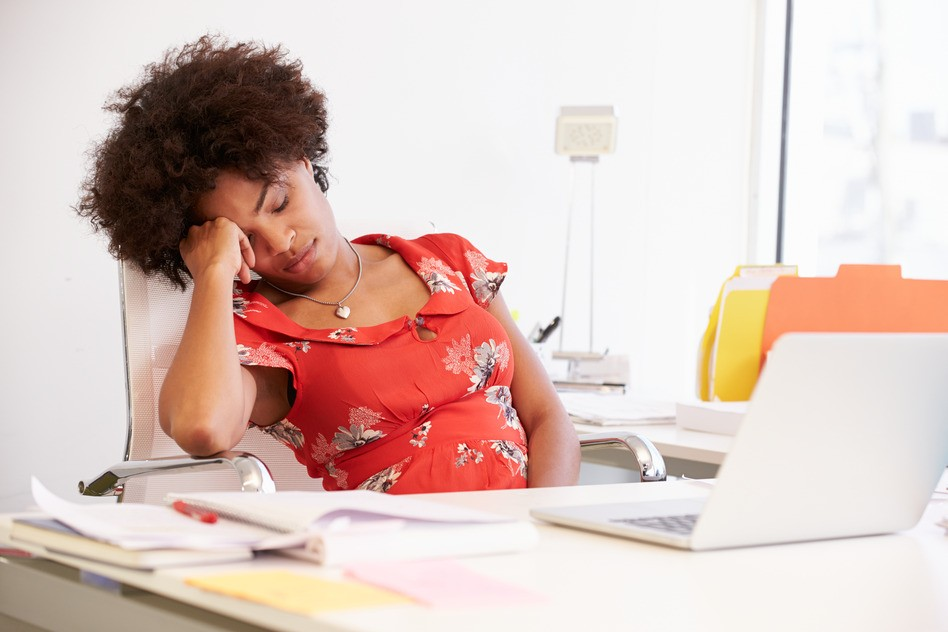 tired woman at desk