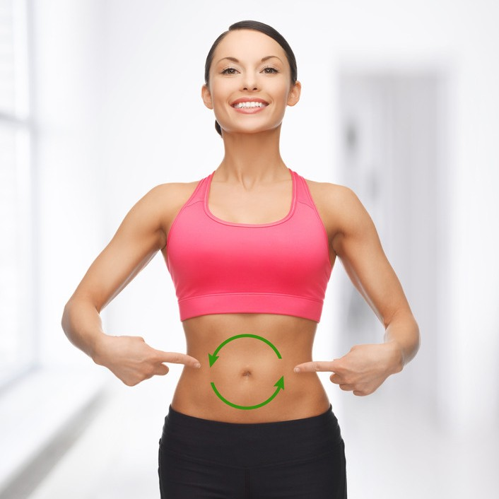 fit woman with arrows making a circle on tummy